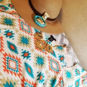Rue21 cold shoulder top in Teal/orange/tan Aztec